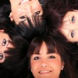 Four young beautiful happy girls - Stockfoto