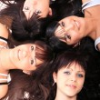 Four young beautiful happy girls - Foto Stock