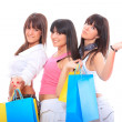 Three girls with shopping bags — Stock Photo