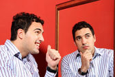 One man, with two faces on the mirror — Stock Photo