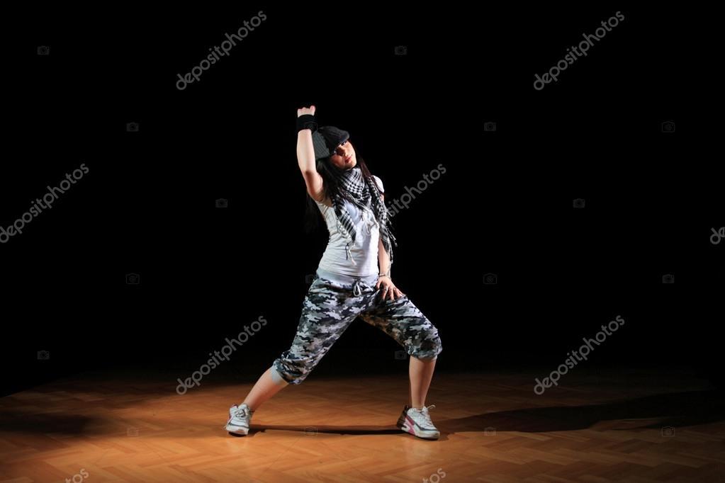 Hip-hop style teenage girl dancing — Stock Photo © netfalls #25507911