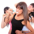 Young Women Brushing their Teeth — Stock Photo #25510081