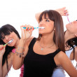 Stock Photo: Young Women Brushing their Teeth