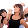 Young Women Brushing their Teeth - Stock Photo