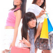 Three girls with shopping bags - Stock Photo