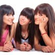 Group of three girls laying  — Stock Photo