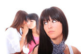 Three attractive girls gossiping — Foto Stock