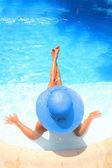 Woman enjoying a swimming pool — Stock Photo