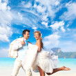 Young couple at their beach wedding - Stock Photo