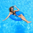 Young woman enjoying the swimming pool - Stock Photo