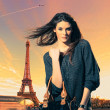 Woman visiting Paris in France with the Eiffel tower — Stock Photo #25579145