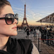 Woman visiting Paris in France with the Eiffel tower — Stock Photo #25580429