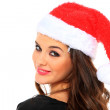Stock Photo: Woman with santa hat