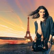 Woman visiting Paris in France with the Eiffel tower — Stock Photo #25582291