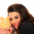 Royalty-Free Stock Photo: Woman with piggy bank