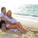 Happy mature couple on the beach — Stock Photo #25630781