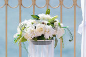 Wedding white bouquet near the beachfront — Stock Photo