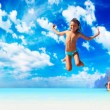 Young girl jumping on the beach  — Stock Photo