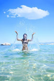 Happy young woman in sea — Stock Photo