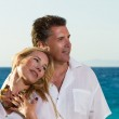 Happy couple on the beach — Stock Photo #26082043