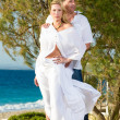 Happy couple on the beach — Stock Photo #26082391