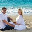 Happy mature couple on the beach — Stock Photo #26082497