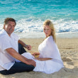 Happy mature couple on the beach — Stock Photo