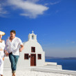 Couple enjoying the honeymoon in Santorin — Stock Photo #27073145