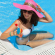 Stock Photo: Pretty brunette womin swimming pool