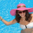 Young woman in the swimming pool  — Stockfoto