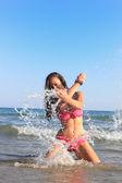 Tropical woman splashing — Stock Photo