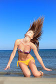 Tropical woman flips hair — Stock Photo