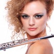 Portrait of a woman playing flute — Stock fotografie
