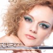 Portrait of a woman playing flute — Stockfoto