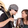 Stock Photo: Handsome young male and female musicians, performers with guitar