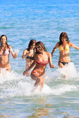Happy teenagers playing in the sea — Stock Photo