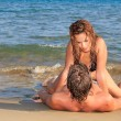 Loving couple on the beach — Stock Photo