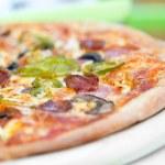 Pizza made with Salami, Mozzarella, Mushrooms, Olives — Stock Photo #27820681
