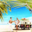 Young couple on holidays at the tropical beach  — Stock Photo