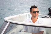 The man has a rest on a yacht — Stock Photo