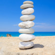 Pebbles stack balance over blue ionian sea in Greece — Stock Photo #27869127