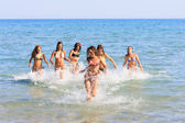 Girls running in the sea — Stockfoto