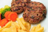 Greek Bifteki with fries — Stock Photo