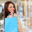 Sexy shopping girl holding bags — Stock Photo
