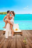 Young couple in love by the swimming pool — Stock Photo