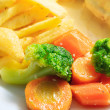 Broccoli, carrots and french fries — Stock Photo
