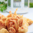 Stock Photo: Fried squids at the restaurant