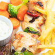 Stock Photo: Chicken skewers with vegetables