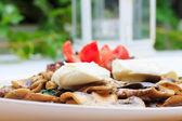 Mushrooms a la creme with mozzarella — Stock Photo