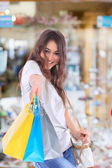Sexy shopping girl holding bags — Stockfoto
